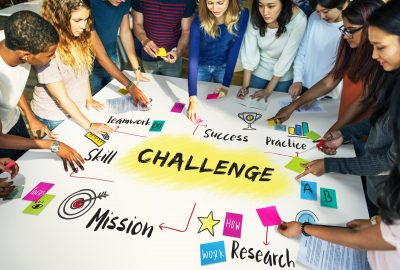 How does the Sales Challenge impact student learning by offering a 'learn-by-rising-to-the-challenge' opportunity?